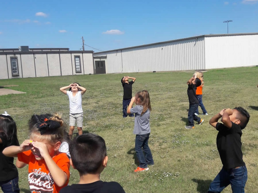 Students watching for migrating Monarch Butterflies in Texas