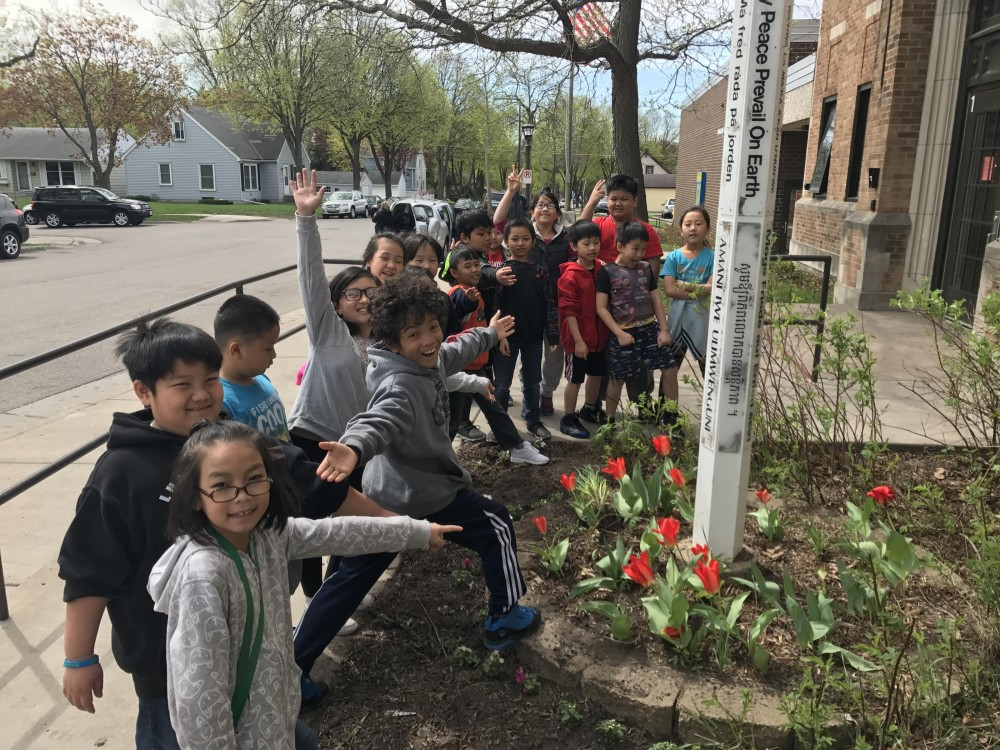 Celebrating tulips blooming around the peace pole