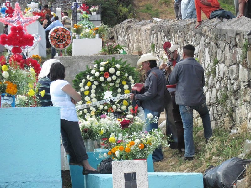 Families gather at the cemetery. Some play live music there, if the beloved relative asked for such celebration. In some parts of Mexico, people stay all night to spend special time with their ancestors.